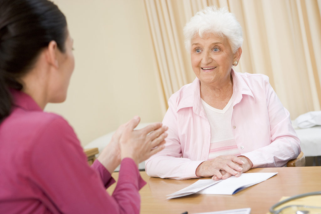 patient speaking with treatment coordinator
