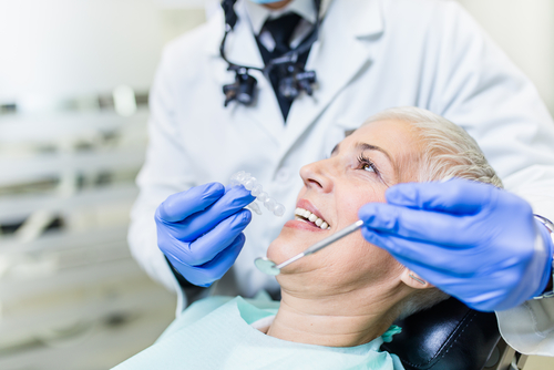 woman getting full arch dental implants