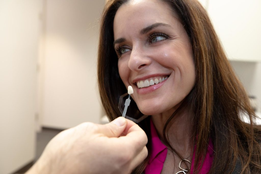 Patient smiles during veneers appointment